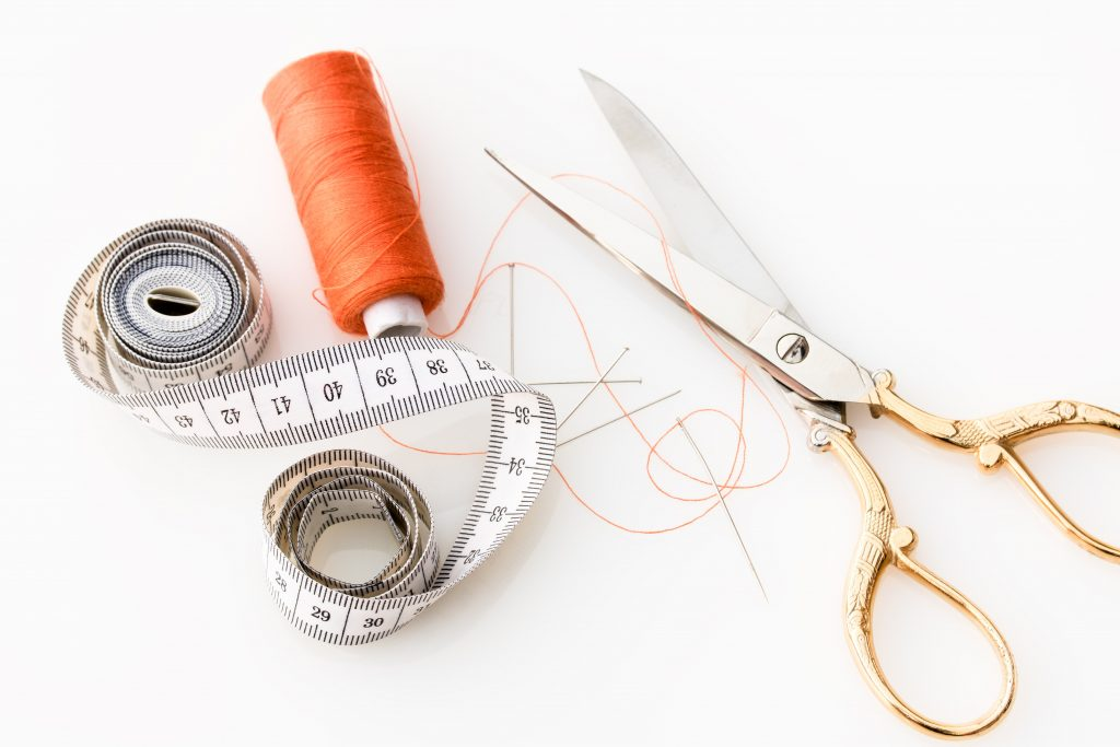Scissor thread and measuring tape