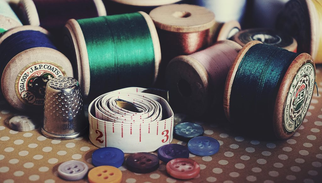 Sewing kit with thread tape thimble