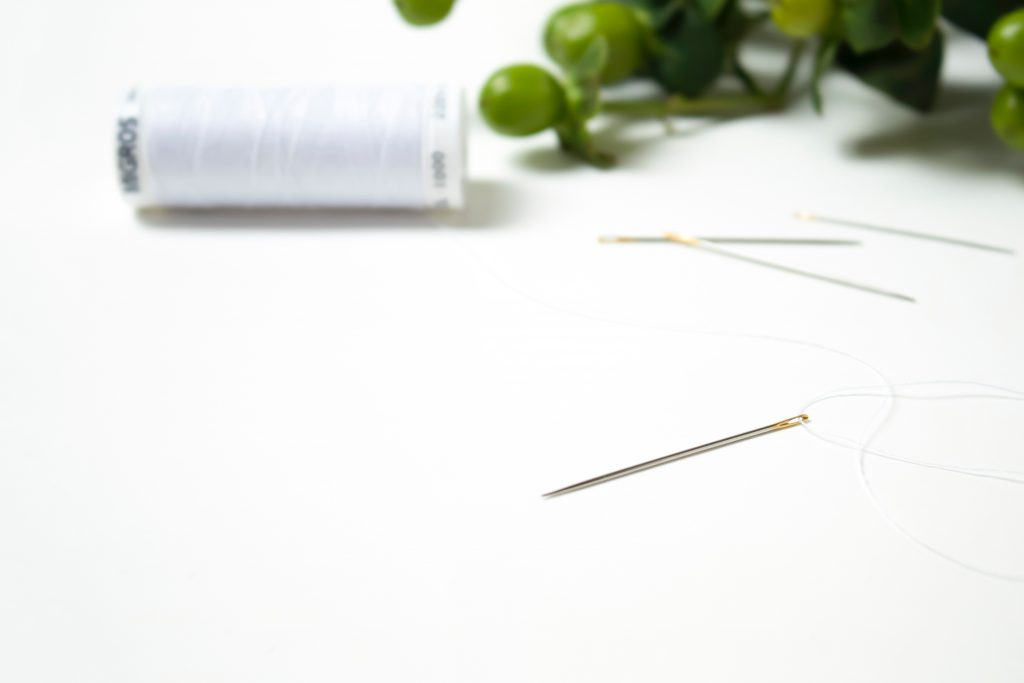 White thread and a Needle