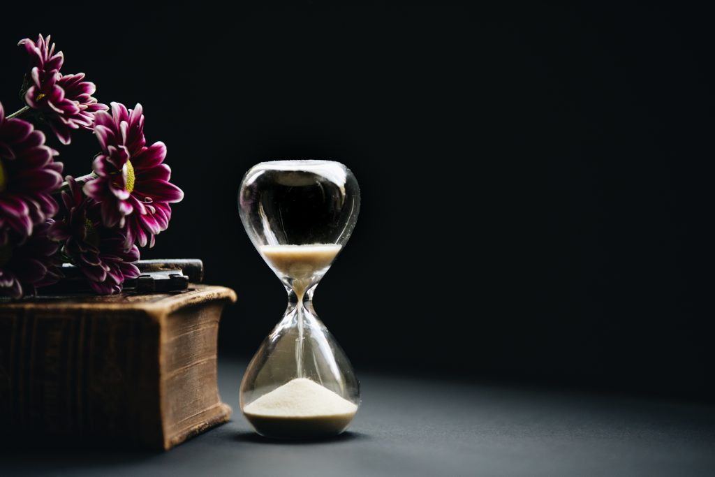 hourglass and flower